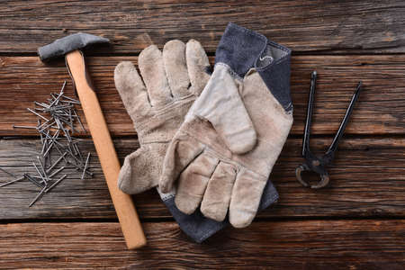 work gloves: hammer, work gloves, pliers and nails - tools carpenter