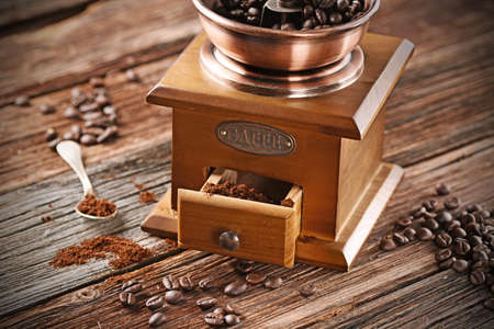 coffee grinder: coffee grinder on wooden table Stock Photo