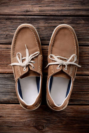 pair of shoes laced on the wooden table Stock Photo