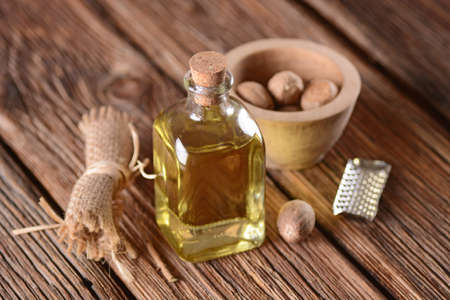 essential oil of nutmeg in the glass bottle