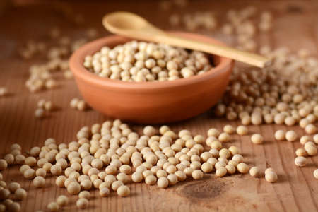 soya beans: soya beans in the bowl in the foreground Stock Photo