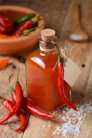 tabasco: tabasco sauce in the bottle with chili around Stock Photo
