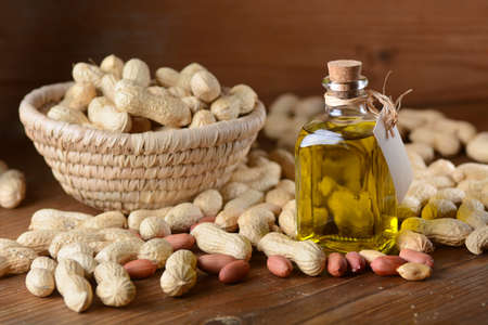 peanut oil in the glass bottle with seeds around