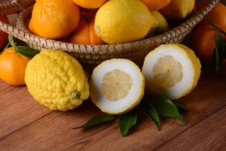 citron fruit sliced on wooden board 写真素材