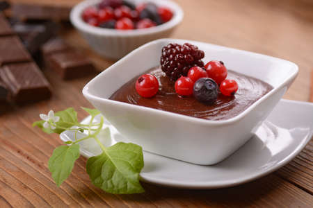 chocolate mousse decorated with berries Stock Photo - 51567783
