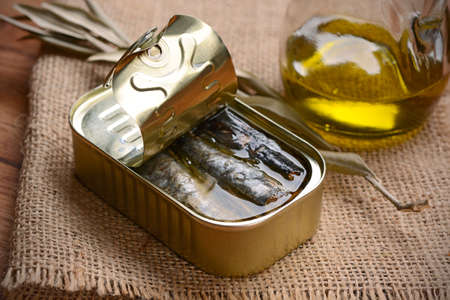 tinned: tinned anchovies in oil on the wooden table