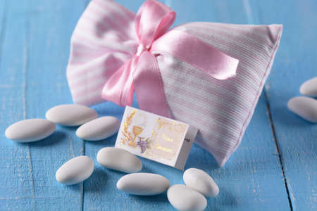 sugared: sugared almonds for baptism on the blue table