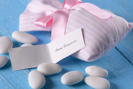 sugared almonds: sugared almonds for baptism on the blue table