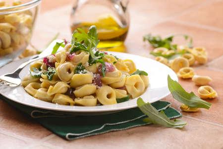 tortellini: Italian tortellini with rocket and red onion