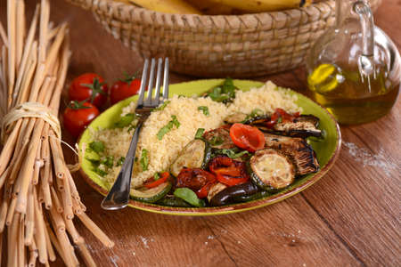 moroccan culture: couscous with grilled vegetables on the plate