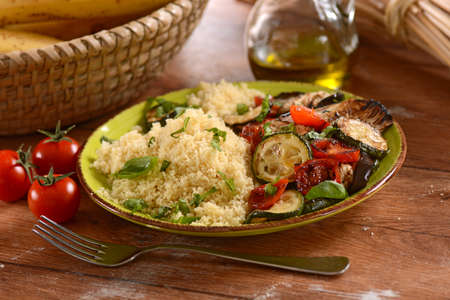 moroccan culture: cous cous with grilled vegetables on the plate Stock Photo