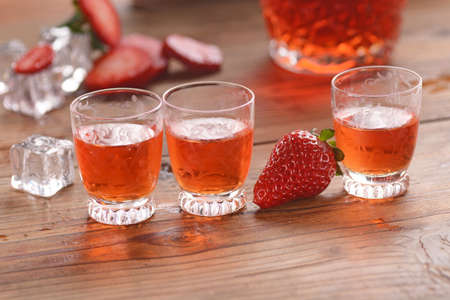 liquor: strawberry liqueur on the table with fruit around