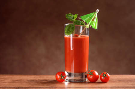 tomato juice: Tomato juice in glass with mint leaf Stock Photo