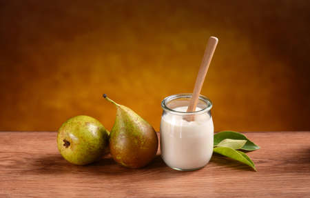 organic yogurt pear in glass jar