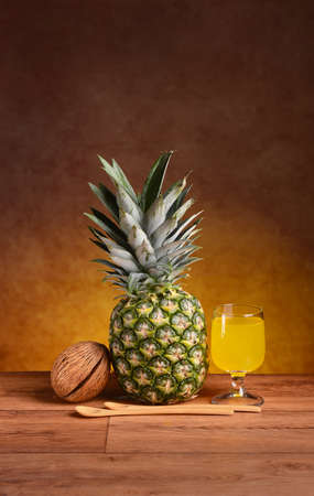 pineapple juice: pineapple juice in the glass on the wooden table