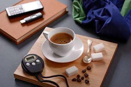 the chronograph: cup of coffee and chronograph on wooden tray Foto de archivo