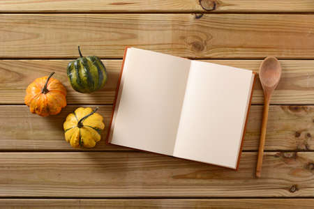 recipe book: recipe book on the table with three small pumpkins