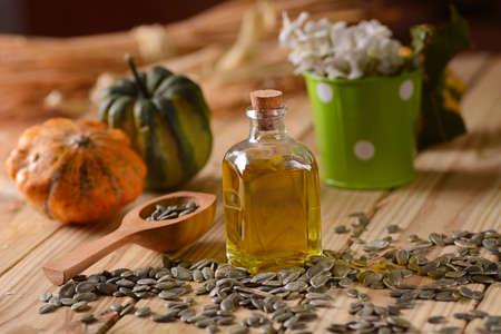 pumpkin seed: pumpkin seed oil in glass bottle