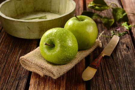 two green apples on jute napkin. Reklamní fotografie