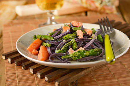 fettuccine flavor of blueberries with salmon and asparagus. Stock Photo