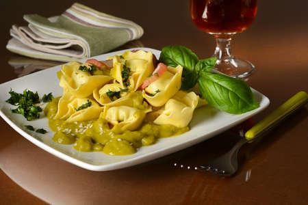 tortellini: Tortelloni with peas cream in the square dish - closeup