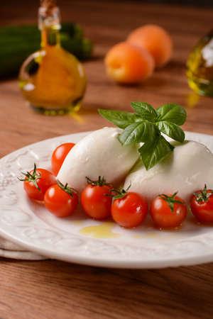 plate: Italian mozzarella and cherry tomato - closeup
