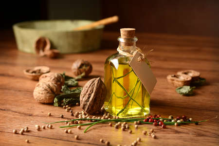 cebollines: Olive oil flavored with walnuts and chives - closeup Foto de archivo