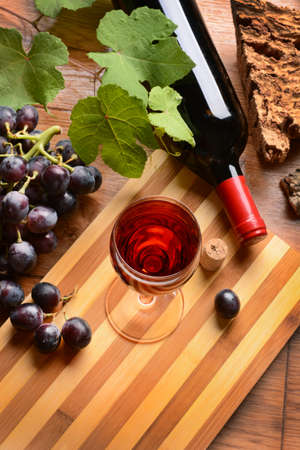 Glass of red wine - wood background - closeup