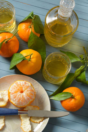 Sicilian mandarin liqueur with fruits around - closeup