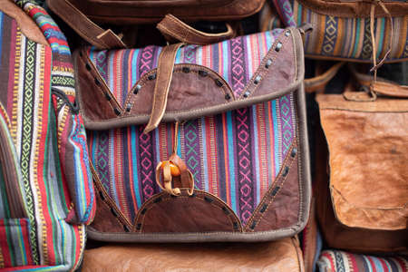 A photo of leather bags with traditional oriental and arabic styles, for sale at a handbag boutique