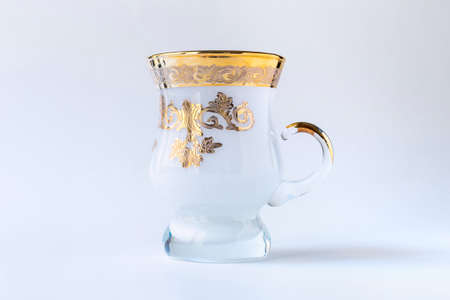 Empty tea glass isolated on white background, empty traditional tea cup