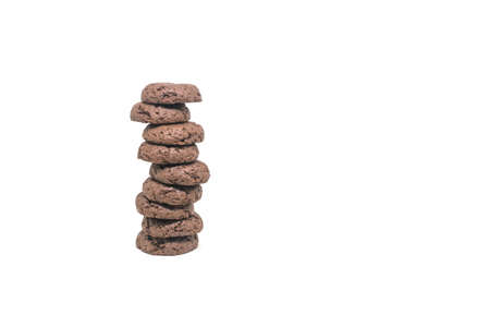 Stack of soft chocolate cookies and brownies isolated on white background
