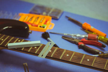 electric guitar on guitar repair desk