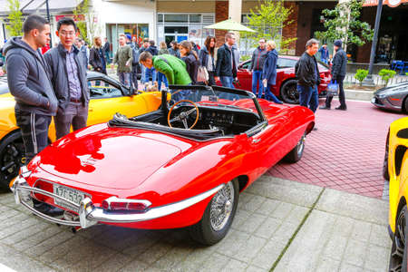 wa: REDMOND, WA - APRIL 29, 2017: Red E type jaguar 4.2 at Exotic car show at Redmond Town Center. The Largest Weekly Gathering Of Exotic Cars In The USA. Editorial