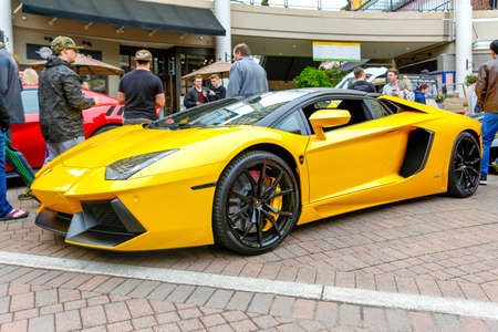 wa: REDMOND, WA - APRIL 29, 2017: Yellow Lamborghini at Exotic car show at Redmond Town Center. The Largest Weekly Gathering Of Exotic Cars In The USA.