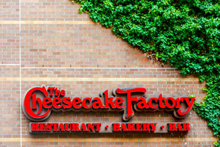 Seattle, WA - April 8, 2017: Photo of The Cheesecake Factory restaurant sign, exterior. The Cheesecake Factory is a restaurant company and distributor of cheesecakes based in the United States. Editorial