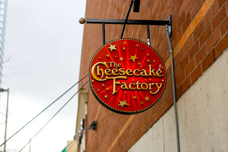 Seattle, WA - April 8, 2017: Round shape signboard of The Cheesecake Factory, a restaurant company and distributor of cheesecakes based in the United States.