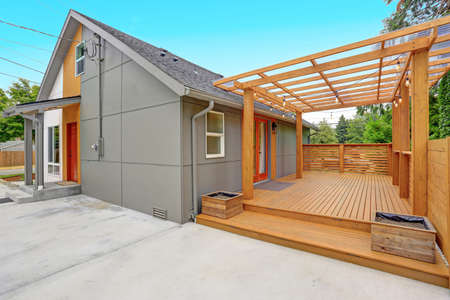 Completely renovated Modern Home in Everett, WA. View of the back yard with spacious concrete patio area and large wrap deck.