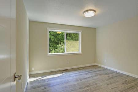 Bright Beige Empty Room With Grey Hardwood Floor. American House Interior  Design. Stock Photo