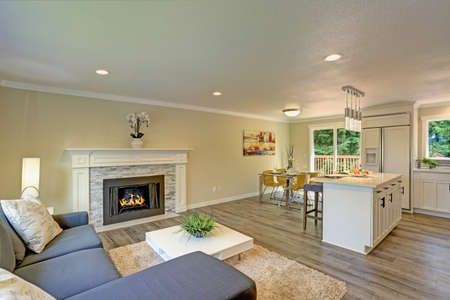 Beautiful open plan second floor living room with dining space and  kitchen. Stock Photo