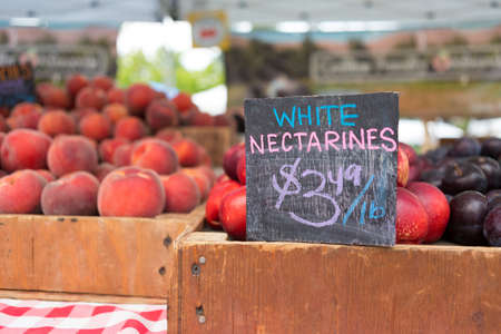 Farmers Market in Bellevue. White nectarines stall with price sign