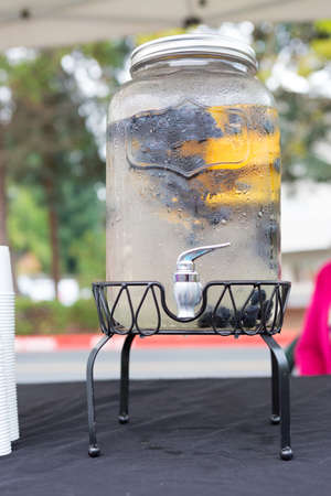 infused: Beverage Dispenser with pouring tap offers a Refreshing summer drink at the Farmers market.