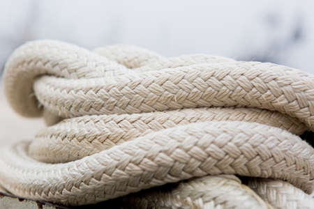 Close-up of a marine white rope on blurred background. Fishermens Terminal in Seattle, WA.