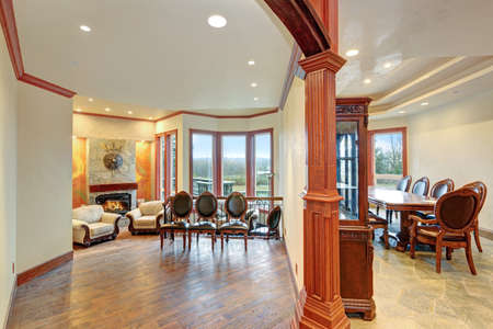 Luxury Bright and airy home interior design boasts wood carved elements.