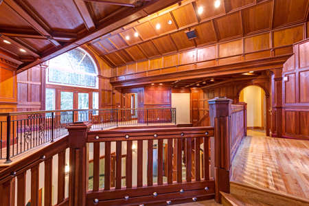 Second floor landing accented with wood paneled walls and ceiling. Amazing wedding venue interior, Seattle, WA.