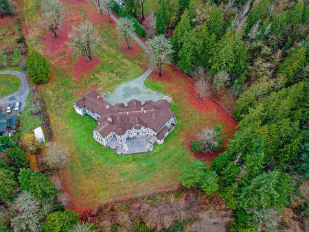 Drone aerial view of a luxurious stone wedding venue in Seattle, WA.