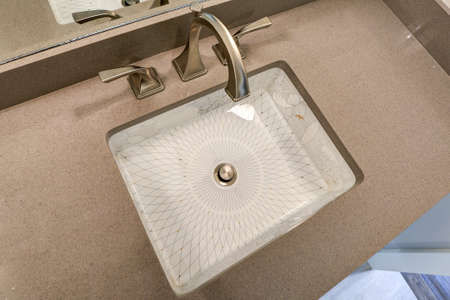 #93392266   Top View Of Modern Bathroom Interior Boasts Luxurious Under Counter  Sink With Chinese Print With Floral Motif And Gold And Platinum Details.