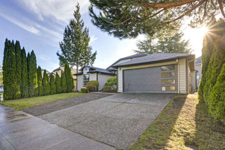 Beautiful curb appeal of a single family home with taupe exterior paint and 1-car garage.