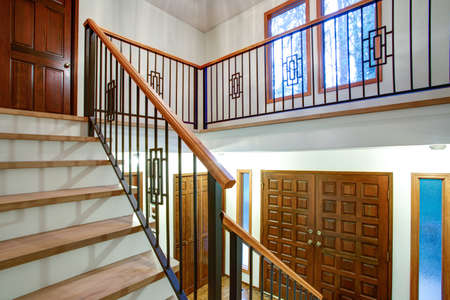 Entrance Hallway boasts Gorgeous wood and iron staircase with mixed iron spindles complementing a wood handrail and light wood treads.