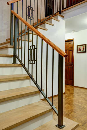 Ordinaire Entrance Hallway Boasts Gorgeous Wood And Iron Staircase With Mixed Iron  Spindles Complementing A Wood Handrail